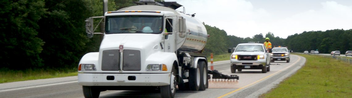 Pavement Technology Inc Application of Reclamite asphalt rejuvenator on four-lane highway