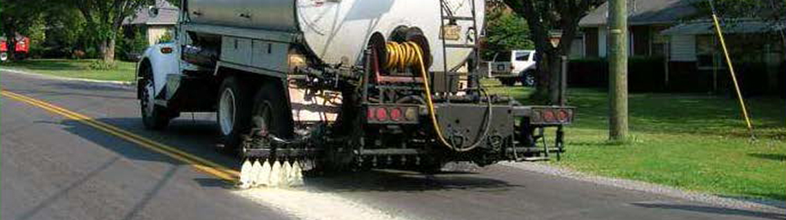 Pavement Technology Inc truck applying JOINTBOND to a residential street