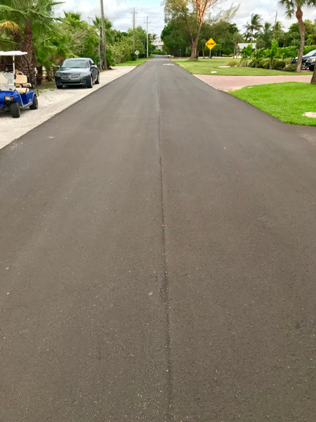 Inspect road pavement around 10 to 11 months within  typical warranty.